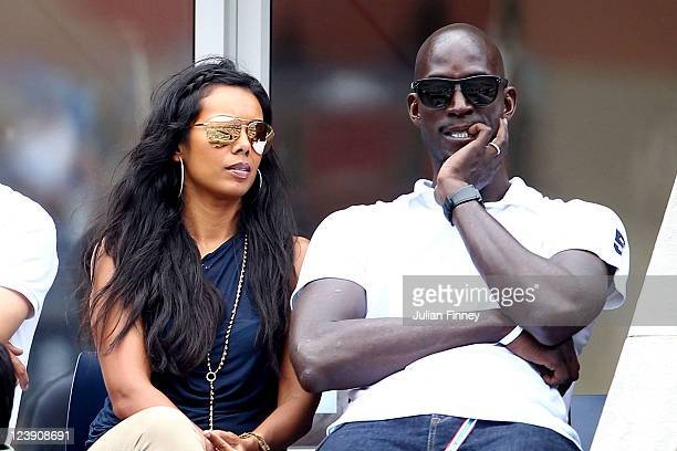 Kevin Garnett of the Boston Celtics and his wife Brandi attend Day Eight of the 2011 US Open at the USTA Billie Jean King National Tennis Center on...