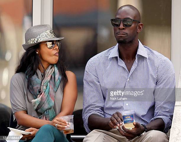Kevin Garnett of the Boston Celtics and his wife Brandi attend Day Eleven of the 2011 US Open at the USTA Billie Jean King National Tennis Center on...