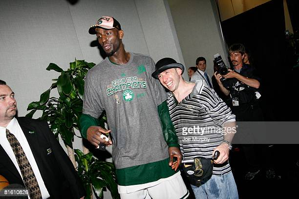 Kevin Garnett of the Boston Celtics and 'Lucky' the team mascot pose for a picture following Game Six of the 2008 NBA Finals against the Los Angeles...