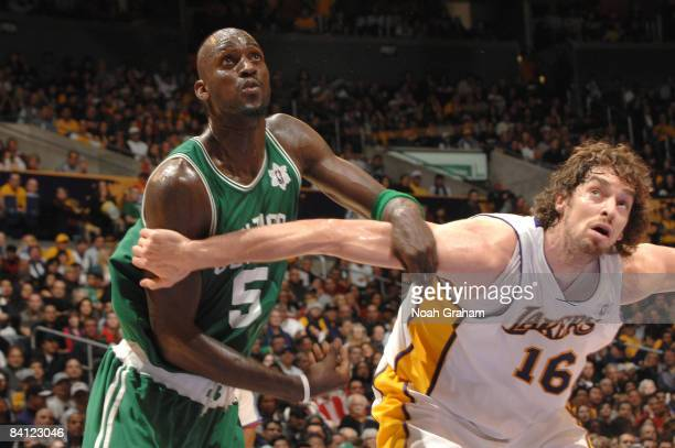 Kevin Garnett of the Boston Celtics and Pau Gasol of the Los Angeles Lakers box out against each other during their game at Staples Center on...