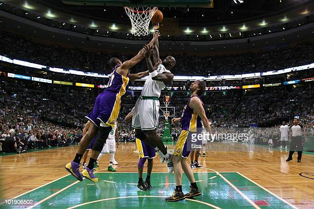 Kevin Garnett of the Boston Celtics attempts a shot against Ron Artest and Pau Gasol of the Los Angeles Lakers in Game Three of the 2010 NBA Finals...