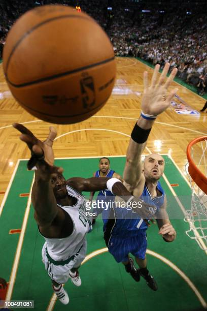 Kevin Garnett of the Boston Celtics attempts a shot in the first half against Marcin Gortat of the Orlando Magic in Game Four of the Eastern...