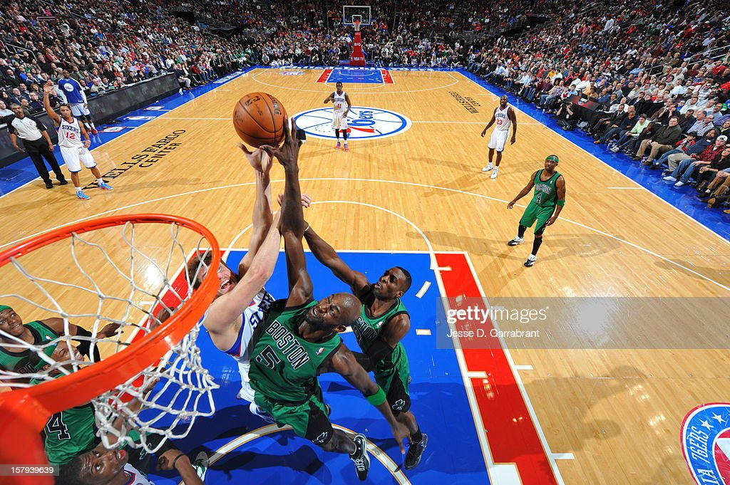 Kevin Garnett #5 of the Boston Celtics blocks a shot against Spencer Hawes #00 of the Philadelphia 76ers at the Wells Fargo Center on December 7, 2012 in Philadelphia, Pennsylvania.