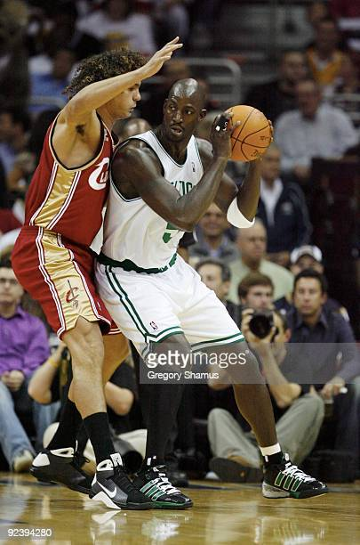 Kevin Garnett of the Boston Celtics drives the ball against Anderson Varejao of the Cleveland Cavaliers during the season opener at Quicken Loans...