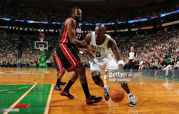 Kevin Garnett of the Boston Celtics drives the ball against Ronny Turiaf of the Miami Heat in Game Three of the Eastern Conference Finals during the...
