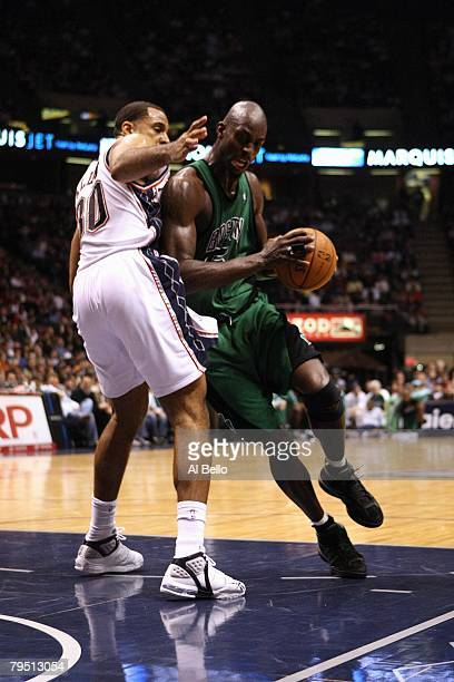 Kevin Garnett of the Boston Celtics drives to the basket against Malik Allen of the New Jersey Nets during the game at the Izod Arena on January 11,...
