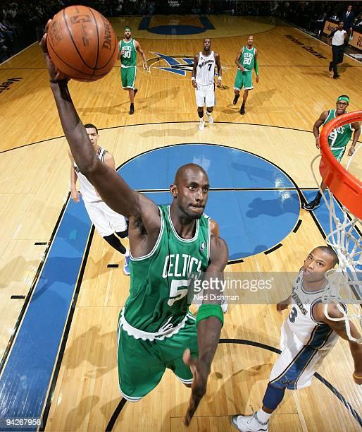 Kevin Garnett of the Boston Celtics dunks against Caron Butler of the Washington WIzards at the Verizon Center on December 10, 2009 in Washington,...