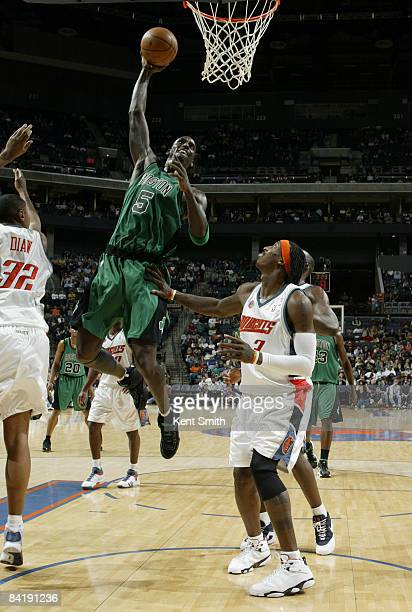 Kevin Garnett of the Boston Celtics dunks against Gerald Wallace of the Charlotte Bobcats on January 6 2009 at the Time Warner Cable Arena in...