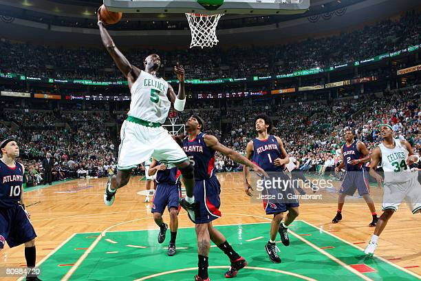 Kevin Garnett of the Boston Celtics dunks against Josh Smith of the Atlanta Hawks in Game Seven of the Eastern Conference Quarterfinals during the...