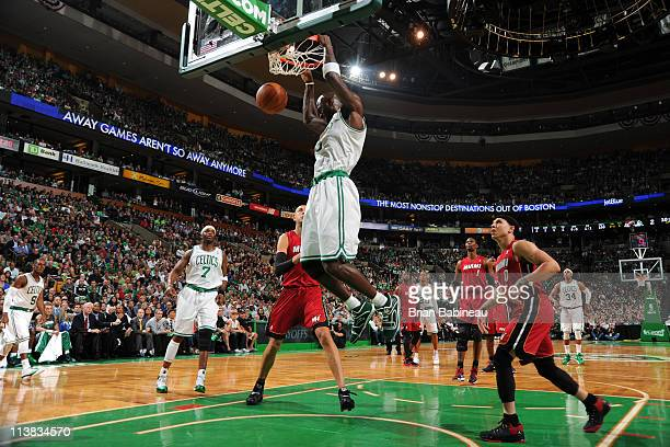 Kevin Garnett of the Boston Celtics dunks against Zydrunas Ilgauskas of the Miami Heat during Game Three of the Eastern Conference Semifinals in the...