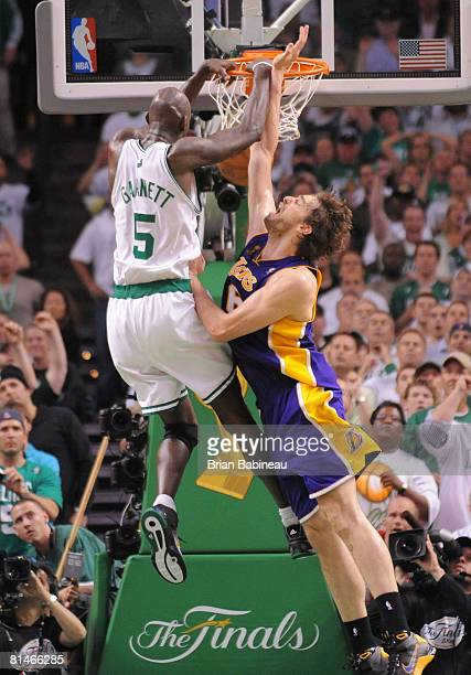 Kevin Garnett of the Boston Celtics dunks the ball against Pau Gasol of the Los Angeles Lakers during Game One of the NBA Finals at TD Banknorth...