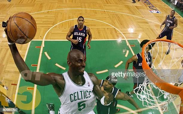 Kevin Garnett of the Boston Celtics dunks the ball as Josh Smith and Al Horford of the Atlanta Hawks defend during Game Seven of the Eastern...