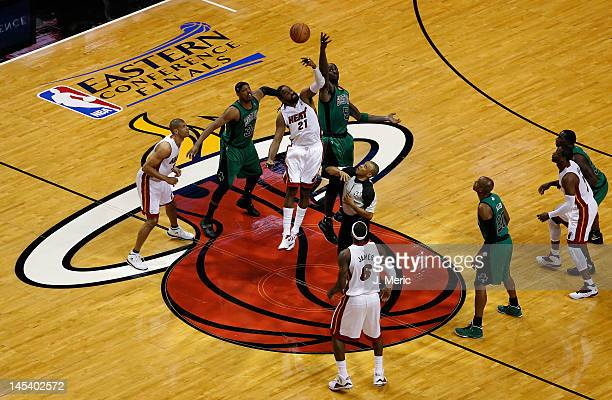 Kevin Garnett of the Boston Celtics fights for control of the opening tipoff against Ronny Turiaf of the Miami Heat in Game One of the Eastern...