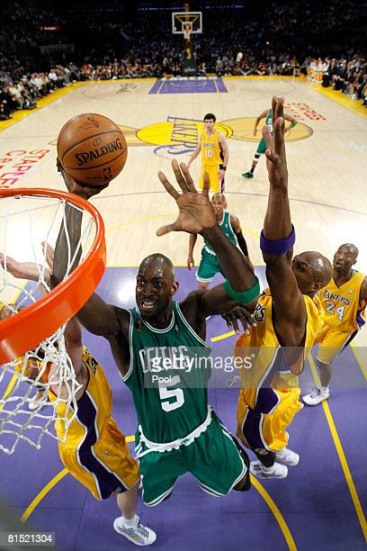 Kevin Garnett of the Boston Celtics goes to the basket over Luke Walton and Lamar Odom of the Los Angeles Lakers in Game Three of the 2008 NBA Finals...
