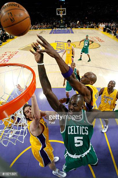Kevin Garnett of the Boston Celtics goes to the basket over Pau Gasol and Lamar Odom of the Los Angeles Lakers in Game Three of the 2008 NBA Finals...