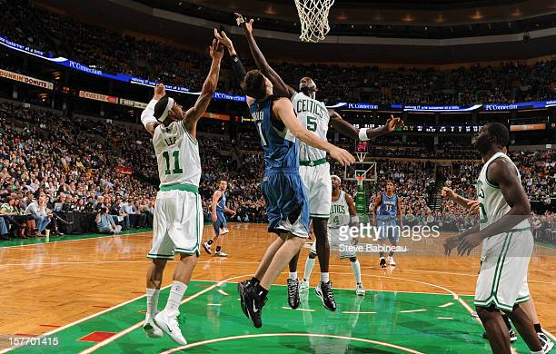 Kevin Garnett of the Boston Celtics goes up for a rebound against Alexey Shved of the Minnesota Timberwolves on December 5 2012 at the TD Garden in...