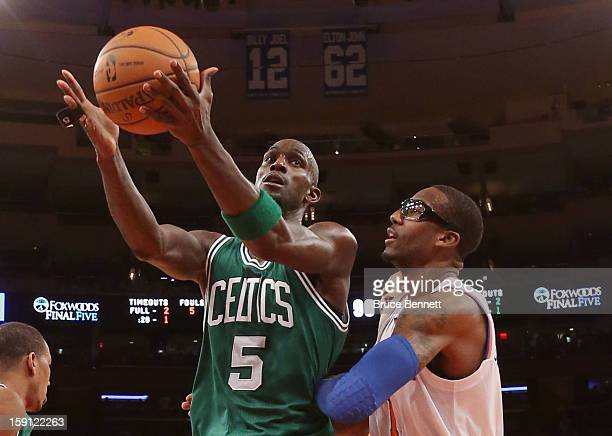 Kevin Garnett of the Boston Celtics grabs a rebound against Amar'e Stoudemire of the New York Knicks at Madison Square Garden on January 7 2013 in...