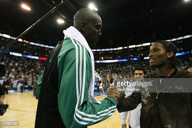 Kevin Garnett of the Boston Celtics greets Didier Drogba, Footballer for The Chelsea Football Club, after a preseason game against the Minnesota...