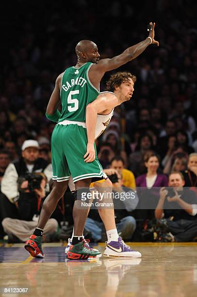 Kevin Garnett of the Boston Celtics guards against Pau Gasol of the Los Angeles Lakers at Staples Center on December 25 2008 in Los Angeles...