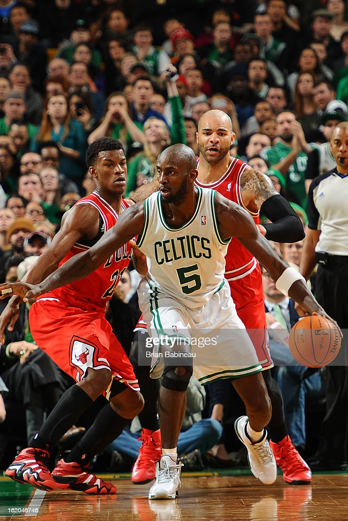 Kevin Garnett #5 of the Boston Celtics handles the ball against Jimmy Butler #21 of the Chicago Bulls on February 13, 2013 at the TD Garden in Boston, Massachusetts.