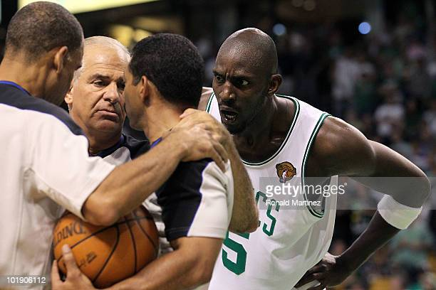 Kevin Garnett of the Boston Celtics looks at the referees as they discuss a call in the fourth quarter against the Los Angeles Lakers Game Three of...