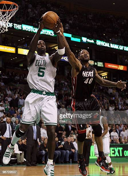 Kevin Garnett of the Boston Celtics nabs the rebound from Udonis Haslem of the Miami Heat during Game Five of the Eastern Conference Quarterfinals of...