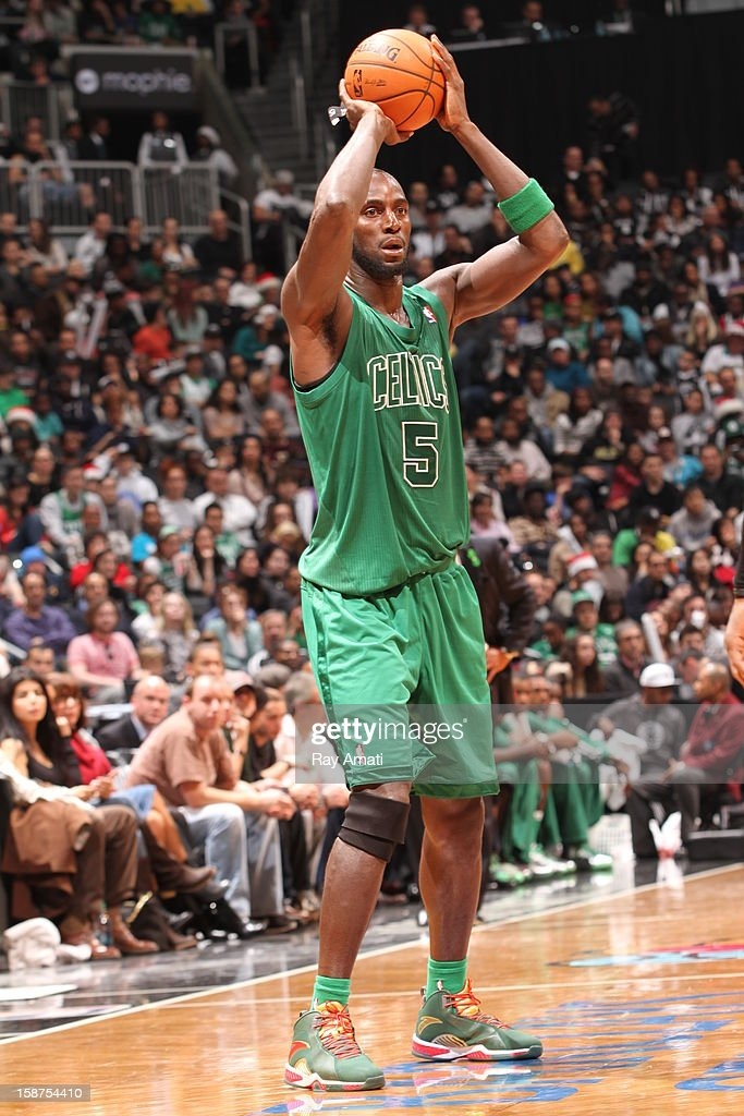 Kevin Garnett #5 of the Boston Celtics passes against the Brooklyn Nets on December 25, 2012 at the Barclays Center in Brooklyn, New York.