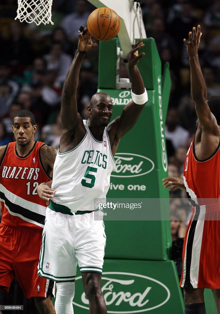 Kevin Garnett #5 of the Boston Celtics passes the ball over Martell Webster #23 and LaMarcus Aldridge #12 of the Portland Trailblazers at the TD Garden on January 22, 2010 in Boston, Massachusetts.