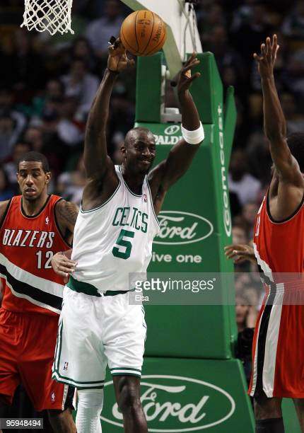 Kevin Garnett of the Boston Celtics passes the ball over Martell Webster and LaMarcus Aldridge of the Portland Trailblazers at the TD Garden on...