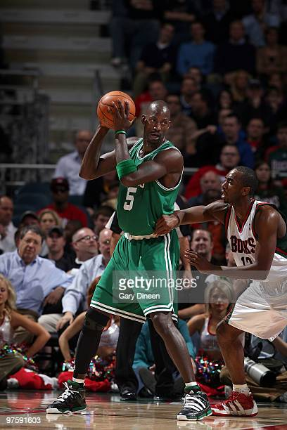 Kevin Garnett of the Boston Celtics posts up against Luc Richard Mbah a Moute of the Milwaukee Bucks on March 9 2010 at the Bradley Center in...