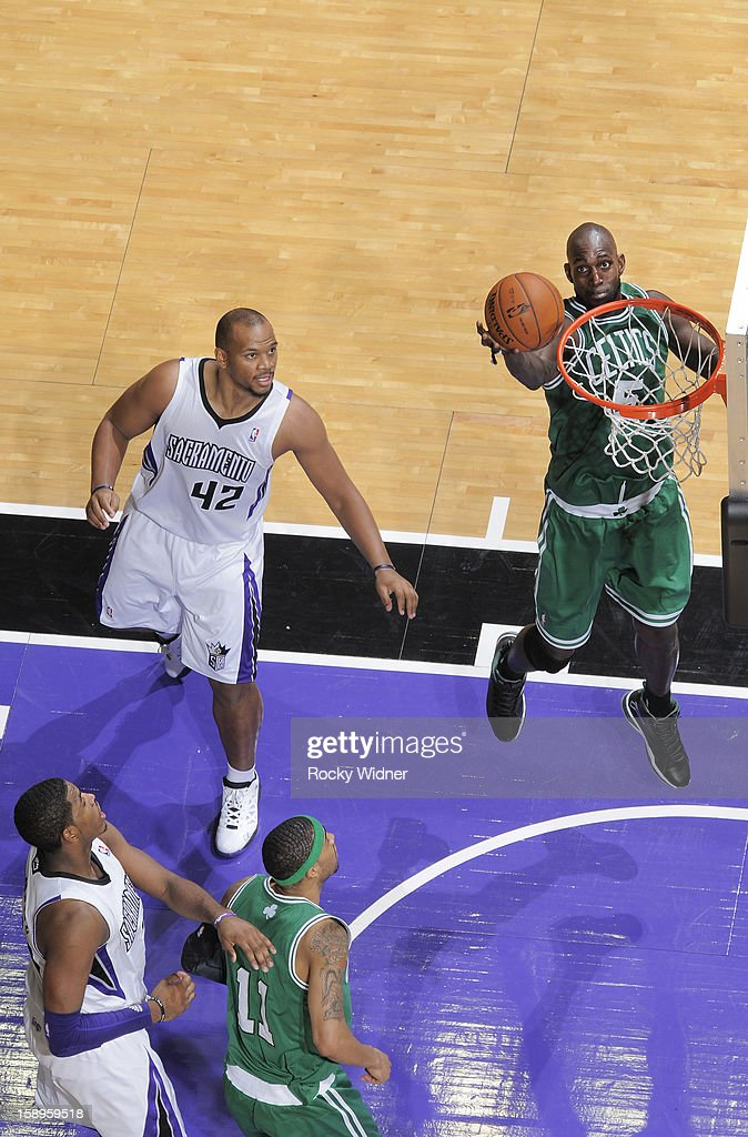Kevin Garnett #5 of the Boston Celtics rebounds against Chuck Hayes #42 of the Sacramento Kings on December 30, 2012 at Sleep Train Arena in Sacramento, California.