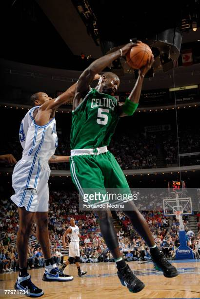 Kevin Garnett of the Boston Celtics rebounds against the Orlando Magic at Amway Arena on November 18 2007 in Orlando Florida NOTE TO USER User...