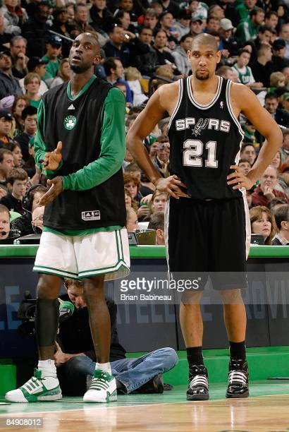 Kevin Garnett of the Boston Celtics rests on the sidelines next to Tim Duncan of the San Antonio Spurs during the game on February 8 2009 at TD...