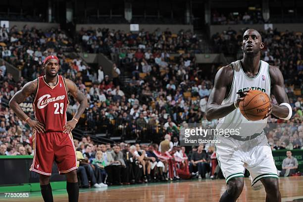Kevin Garnett of the Boston Celtics shoots a foul shot as LeBron James of the Cleveland Cavaliers watches in NBA preseason action October 26 2007 at...