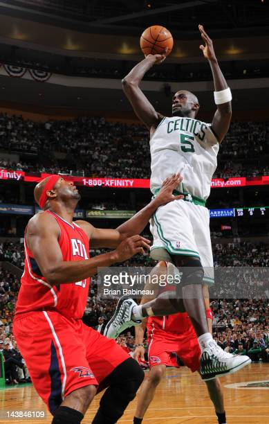 Kevin Garnett of the Boston Celtics shoots against Erick Dampier of the Atlanta Hawks in Game Three of the Eastern Conference Quarterfinals during...