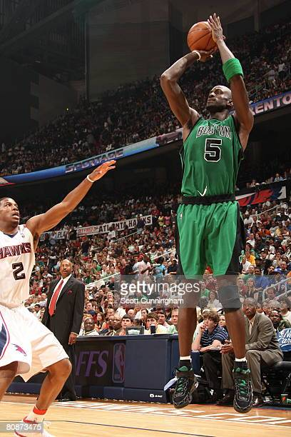 Kevin Garnett of the Boston Celtics shoots against Joe Johnson of the Atlanta Hawks in Game Three of the Eastern Conference Quarter Finals during the...