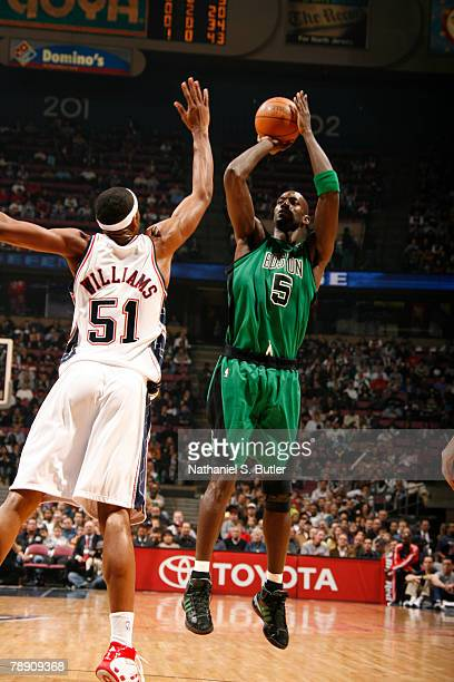 Kevin Garnett of the Boston Celtics shoots against Sean Williams of the New Jersey Nets on January 11 2008 at the IZOD Center in East Rutherford New...