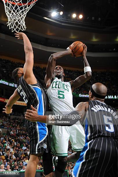 Kevin Garnett of the Boston Celtics shoots the ball against Chris Duhon and Quentin Richardson of the Orlando Magic on April 18 2012 at the TD Garden...