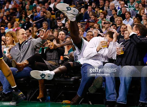 Kevin Garnett of the Boston Celtics spills into the fans sitting in the courtside seats attempting to grab a loose ball against the Indiana Pacers...