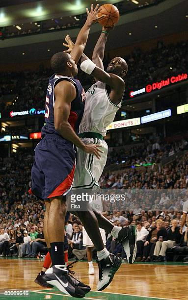 Kevin Garnett of the Boston Celtics takes a shot as Al Horford of the Atlanta Hawks defends on November 12 2008 at TD Banknorth Garden in Boston...