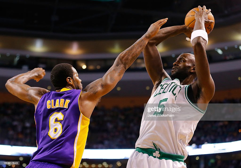 Kevin Garnett #5 of the Boston Celtics takes a shot over Earl Clark #6 of the Los Angeles Lakers in the second quarter during the game on February 7, 2013 at TD Garden in Boston, Massachusetts.