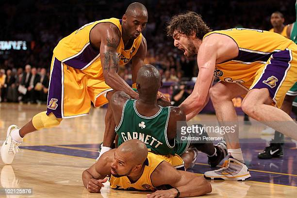 Kevin Garnett of the Boston Celtics tries to hold on to the ball under pressure from Kobe Bryant Derek Fisher and Pau Gasol of the Los Angeles Lakers...