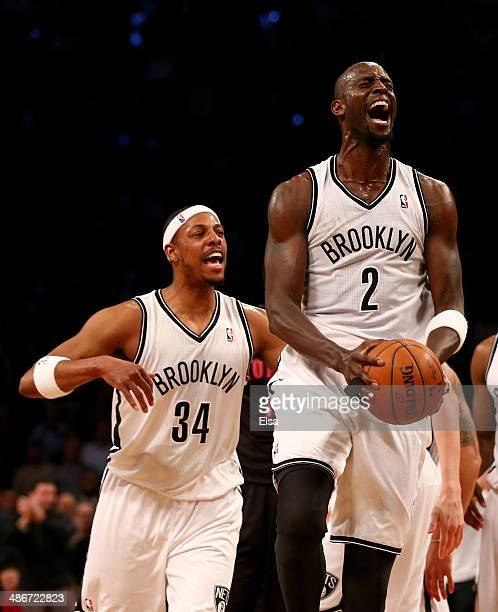 Kevin Garnett of the Brooklyn Nets celebrates after he got the loose ball with teammate Paul Pierce in the second quarter against the Toronto Raptors...