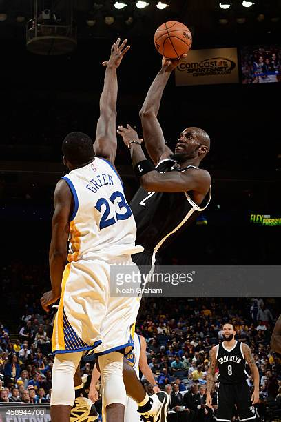 Kevin Garnett of the Brooklyn Nets takes a shot against the Golden State Warriors on November 13 2014 at Oracle Arena in Oakland California NOTE TO...