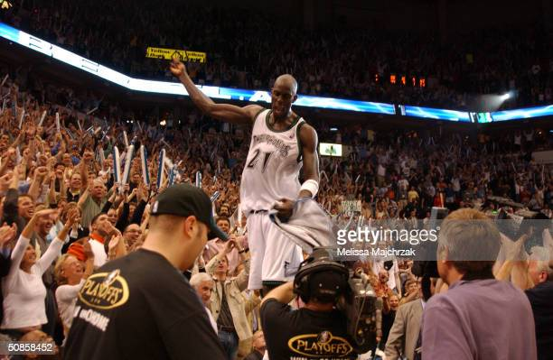 Kevin Garnett of the Minnesota Timberwolves acknowledges the crowd after winning Game Seven against the Sacramento Kings in Game Seven of the Western...