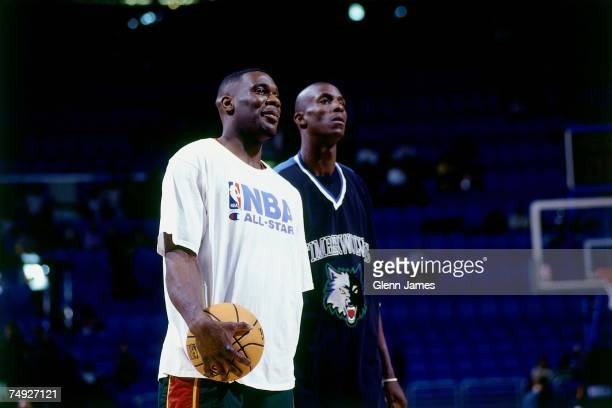 Kevin Garnett of the Minnesota Timberwolves and Shawn Kemp of the Seattle SuperSonics chat during warmups before the 1997 NBA AllStar Game on...