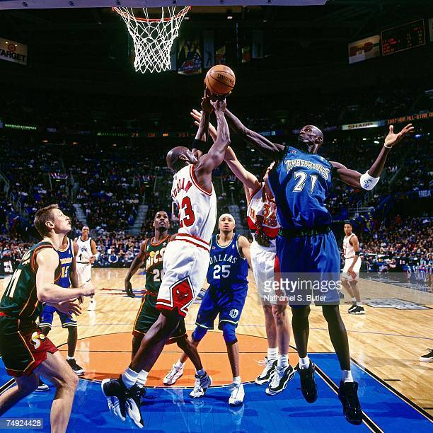 Kevin Garnett of the Minnesota Timberwolves battles for a rebound during the 1997 NBA AllStar Game on February 9 1997 at the Gund Arena in Cleveland...