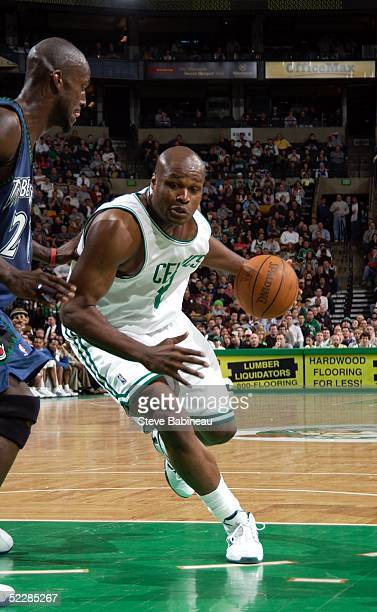 Kevin Garnett of the Minnesota Timberwolves defends against Antoine Walker of the Boston Celtics March 6 2005 at the Fleet Center in Boston...