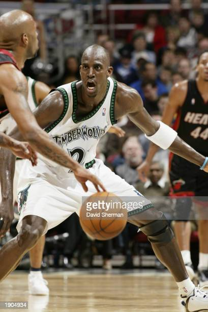 Kevin Garnett of the Minnesota Timberwolves defends against the Miami Heat during the game at Target Center on March 25 2003 in Minneapolis Minnesota...