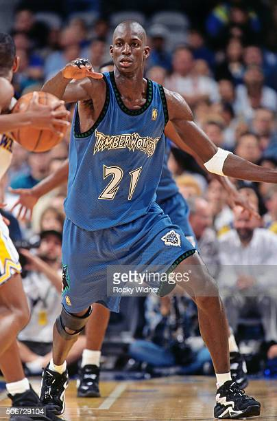 Kevin Garnett of the Minnesota Timberwolves defends against the Golden State Warriors circa 1997 at the Arena in Oakland in Oakland California NOTE...
